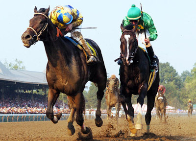 Street Sense [left] and Calvin Borel hold off Grasshopper and Robby Albarado to win the 2007 Travers Stakes