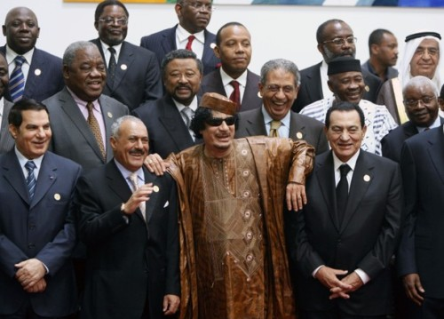 newsweek-paris-france:  And there's Ali Abdullah Saleh of Yemen with Qadhafi's hand on his shoulder, and really yucking it up behind them, Amr Moussa, then the head of the Arab League, now an aspiring contender to become the first democratically elected president of Egypt.  theatlantic:  Qaddafi with Mubarak and Ben Ali, One Year Ago    Taken less than a year before, the photo captured the ear-to-ear smiles of the leaders of several autocratic regimes. At the center of the photo stood Gaddafi, smiling and resplendent in his golden-brown robes and trademark sunglasses. To his far left stood then-Tunisian President Zine El Abidine Ben Ali, laughing, and looking for all the world like he was invincible. To his right stood then-Egyptian President Hosni Mubarak, with Gaddafi's elbow jauntily on his soldier.    Via The Washington Post