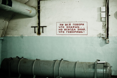 "Found on a wall in the former nuclear submarine facility in Balaklava, Crimea, Ukraine. Do not say all that you know,but always know what you are saying! (could be culturally translated as: ""Loose lips sink ships!"" perhaps)"