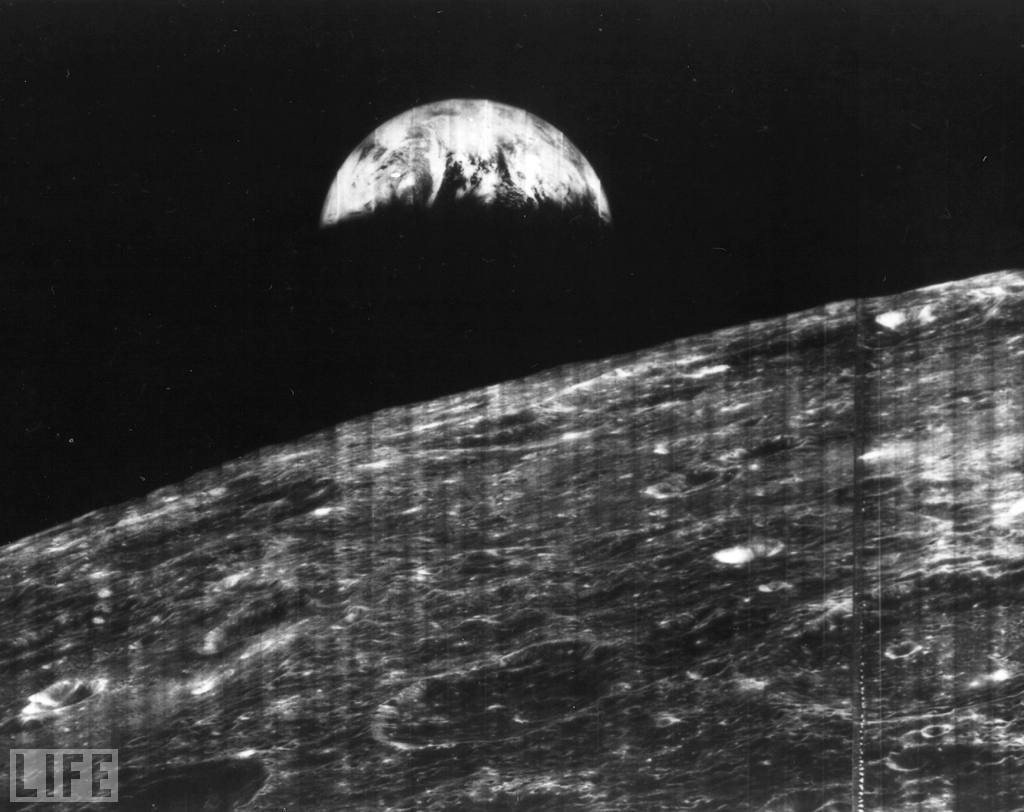 life:   On Aug. 23, 1966, humanity welcomed its first view of Earth taken by a  spacecraft from the vicinity of the Moon. The photo was transmitted to  Earth by NASA's unmanned Lunar Orbiter I — a robotic surveyor sent into  orbit to map possible lunar landing sites years before the Apollo  program — and was received at a NASA tracking station near Madrid,  Spain. In celebration of the 45th anniversary of the landmark  transmission, LIFE.com presents other remarkable, moving, humbling  photos of our lonely blue and green planet taken from the depths of  space. Out of this world, literally: Earth Seen From Space