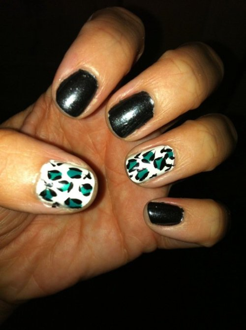 lacey:  Teal and black nails.  Stolen idea from Heather (who has some of the best nail designs ever that are easy to emulate)