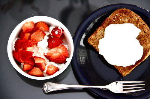 Cottage Cheese w/ Strawberries & Poached Egg on Ezekiel Bread  last breakfast in the states … i had to channel some red white and blue :)