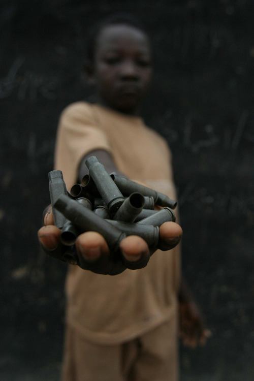 Child in a rebel camp in the north-eastern Central African Republic. Photo by Pierre Holtz.