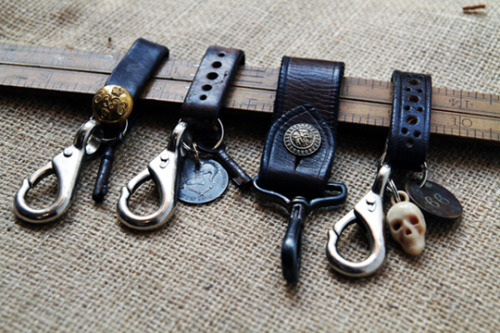 "Vintage Showroom Keychains ""The guys at The Vintage Showroom have been receiving a lot of attention at the moment and deservedly so. Their ever growing collection of American and European vintage housed in a spacious West London studio would blow the mind of even the most seasoned collector. Their equally impressive retail space in Covent Garden is heavy on atheletic, knitwear and military (specifically naval) goods as well as some amazing outerwear including a nice range of old barbours. Among their accessory collection you'll find their range of vintage keychains, 're-using antique belt leather, objets trouvé, and chunky metal hardware', the perfect way to cheer up your belt loop. -ld"""