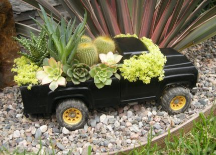 "truebluemeandyou:  DIY Toy Truck Planter. From FundementoDesigns at JunkMarketSyle here. How it was done:  ""I've been planting toy trucks lately. When this one arrived it was just too ugly to plant so I got out the spray can, masking tape and plastic wrap. I knocked out the old opaque plastic windshields, cut & glued a piece of wood over the holes under the cab, painted, stuffed the cab with moss, fashioned wire screen for a tailgate, added dirt & plants."