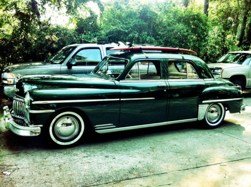 Chris' 1949 De Soto, which was his grandfather's car. Pretty bad ass with a surfboard on top!