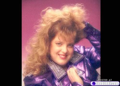This has everything you could want in a Glamour Shot. Big hair that brings you closer to Jesus? CHECK Shiny Metallic Outfit? CHECK Make to make you look like you're back in high school in Texas in 1978? CHECK Holding your head up with one hand? CHECK Pulling on your collar to pop it like an early 80's country singer? CHECK If we were rating these this would get top marks. But we're not. We're just laughing our heads off.
