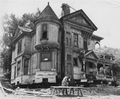"memoriastoica:  Exterior view of the Hale House, a ""Carpenter Gothic""  style structure. Designed by George W. Morgan and built in 1887, this  home was declared a historic monument by the Los Angeles Cultural  Heritage Board in June 1966.  It is called an ""outstanding example of  the late Victorian period in Los Angeles… and embodies the essence of  most of the typical features of this historic style."" It was first  located at 4501 North Figueroa (originally Pasadena Avenue), then moved  to 4425 North Figueroa, the location shown here. It is being readied to be  moved to Heritage Square Museum. Circa 1970."