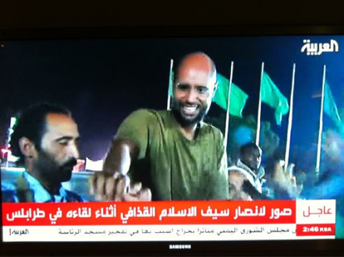 "kateoplis:  Saif Al Islam Gaddafi is seen in Tripoli tonight and claims his detention was a trick by the rebels. ""I am here to refute all the allegations. NATO & the West have advanced technology, they sent Libyans messages I don't know how…"" Unbelievable.  Holy hell."