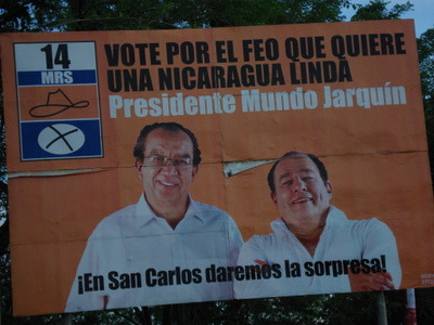 "2006 Campaign billboard for MRS (Sandinista Renovation Movement) presidential/VP candidates Edmundo Jarquin and Carlos Mejia Godoy. It says ""Vote for the ugly guy who wants a beautiful Nicaragua."" Photo by sandramartineflores."