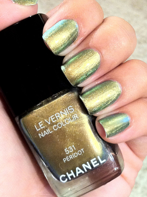Peridot: Now Playing: Peridot, Le Vernis Chanel ($25) LIMITED EDITION Well here it is: the most buzzed about fall color… Chanel Peridot. Let me tell you, it sure lives up to the hype. This duo-chrome color is unlike any I've seen. Peridot is a warm gold with hints of copper and in different lighting green and turquoise radiate and add dimension. Two coats are all I needed to make it completely opaque. I keep wanting to describe this color as an underwater sea creature or a snake eye of sorts. Either way this polish is sexy and exotic. If you're smart, you'll run out and get this color before it's gone for good (see below). Many thanks to all 8 employees at the Macy's Chanel counter who not only dealt with me whining about it being sold out, but called every department store in the city to track it down… oh, and for letting me manicure myself with the tester bottle in my moment of desperation.