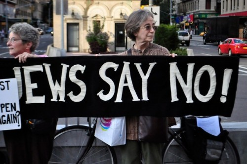 "laceandcombatboots:  israelfacts:  The ""Jews Say No"" movement held a protest in Upper Manhattan expressing their opposition to the recent air attacks by Israel on the Gaza strip. Protesters stood silently, holding posters and placards which voiced their concerns. New York, USA. 22nd August 2011 (Demotix Images)  I've always struggled to reconcile my Judaism with my feelings on Israel. My grandfather fought for Israel's independence, he was in charge of the defense of Exodus, he helped thousands of Jews emigrate from war-torn Europe. He was friends with fucking Golda Meir. And I loved him unreservedly. He was the kindest, most generous man I've ever known. He lavished me with gifts, he'd order every dessert off the menu when out with family, just for the hell of it. And yet he lived very humbly, and wore the same clothes every day. He was like a cartoon character- an entire closet full of the same shirts and pants. And he devoted so much of himself, his life, to the founding and preservation of Israel. He'd endured beatings, imprisonment, prejudice. I don't know what I'm getting at. I guess, because he meant so much to me and because Israel meant so much to him, I have a hard time separating the two. Plus, HALF of the world's Jews live in Israel, and three-quarters of the Israeli population is Jewish. There are a LOT of valid criticisms against the country of Israel, but it is sometimes connected with anti-semitism (obviously, not in this instance). Jews make up less than 1% of the world population… to think of how volatile the Middle East is right now, and how many live there… it's a scary thing.  I love these pictures. As an Israeli, I feel that these people are showing true solidarity with me, and with everyone else living here who cares about this place and who is fighting to end the occupation, siege and apartheid against the Palestinians. For me, caring about this little patch of land and the people inside it doesn't mean supporting Israel and its governments' militarist and oppressive regimes, it means resisting them. (Note that I intentionally don't say that I care about Israel. The existence of the state is something I have little concern about: I care about people, not countries.)"