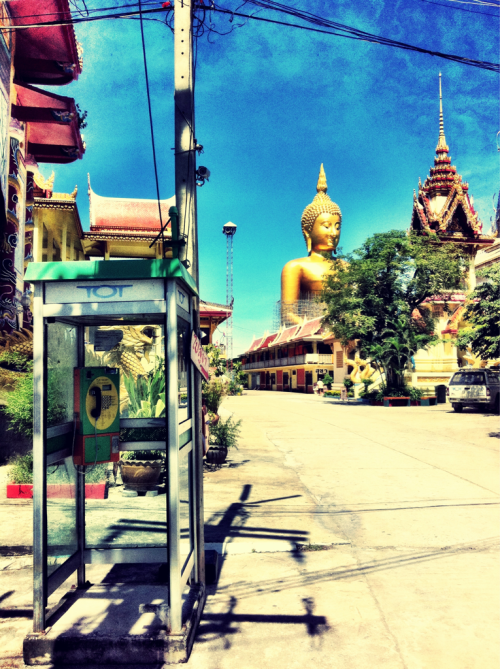 Oh my Buddha.  (Taken on my iPhone)  The Wat Muang Buddha as seen from the wat's entrance.