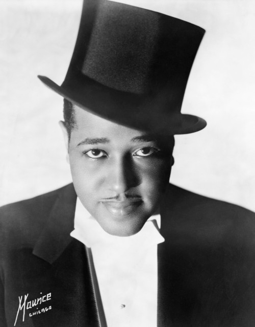 "I wanted to kick off our second Duke Ellington day by talking about some of the barriers people can have to getting into very old music like this, and why I think it's important to at least understand it, rather than relying on second-hand recreations from decades later. Yesterday, on my personal Tumblr, I asked people why they thought they (or people in general) had trouble getting into older recordings, especially of the pre-high-fidelity era, and the responses I received were illuminating. Several people cited the low fidelity of the music itself — and especially for audiophiles who want to hear every detail crystal clear through their high-end headsets or speakers, this can be a dealbreaker. Music, or sound, that doesn't lend itself to such complete immersion is functionally useless for them; past a certain point, you can't even turn it up to hear it better, since the dynamic frequency of the original track is so low that it just warps and garbles into hiss. Others were fine with the fidelity — after all, if some of us are used to hearing music played through laptop speakers, phones, and Apple's shitty white earbuds, the narrowly-compressed range of old records may actually pump through our tinny outputs better than more delicate sounds. But trying to figure out the context for these old sounds was more daunting to them: after several generations have passed, what once sounded fresh and vital may now sound stiff and hokey, or just incomprehensible. People listened to that? Why? What pleasure could they possibly get from it? Or worse, the intervening years have accreted other contexts and associations onto it, so that many people can't listen to old records without thinking of the dull documentaries they were used to score, or the creepy horror movies that use the rustle and shriek of old 78s to ominous effect. And of course, some people just don't see the point. Michelle smartly noted that listening to old records doesn't provide you with any social capital the way listening to new music or even classic rock does — for the most part, you can't talk about it with your friends, and there's not even any real critical establishment insisting on the eternal value of the music in the way the Boomer (and more recently the Gen X) pantheon is endlessly celebrated. If nobody's either asking or haranguing you about it, if you have to seek it out but then once you do there's not a clear subculture in which to talk about it, what't the point? That answer fascinated me, because I've rarely gotten any social capital out of listening to any music at all. I've always swum more or less alone, so in diving ever further down into the waters of history, I was leaving nobody behind. I don't have any answers to these objections; as far as I can see, they're all perfectly valid, and I don't blame anyone for not wanting to listen to music that gives them no pleasure, that they don't understand, or that doesn't enrich their lives. All I have to offer is personal history, so idiosyncratic as to be non-replicable. In short, I was curious, so I dug. I've always, since I was a small child, been historically-minded; my favorite movies are all black and white, my favorite books are all older than my parents or even my grandparents are, and even many of my favorite comics are newspaper strips of the kind that died out in the 50s and 60s. When, inspired by all the ""Greatest _____ of the Century"" lists that came out around the turn of the millennium, I turned to that other great turn-of-the-millennium fad, Napster, to start trawling through the decades, it seemed only fair to be as interested in the music of the Thirties, Twenties, Teens, and Oughts as in the Fifties, Sixties, Seventies, and Eighties. And so, piece by piece, record by record, I began reconstructing the past. I don't know any other way to do it. I still know very little, compared to all that there is to know. (People who focus on a single era, on a single branch of music, on a single discography, are as incomprehensible to me as I'm sure I am to many of you.) But I am, after ten years, comfortable enough flitting among the many and varied worlds captured on 78s that what sometimes appears to me to be a snobbish, finicky, or simply ignorant preference for recreations or revivals of this music using later technology, later arrangements, or later understandings seems more and more disrespectful and even, in a sense, pernicious. I want to be clear about this: there is no such thing as definitivity. Duke Ellington's 1966 recordings of ""Creole Love Call"" and ""Black and Tan Fantasy"" are just as valid as the ones from 1927; and recordings of those same tunes made by your high school jazz club last year are too. Music is music; get your pleasure where you can. What irks me is the implicit assumption that later is better, for whatever reason — better dynamic range, greater availability on compact disc, the crude solipsism of one's own existence being contemporaneous with that of the performance. I don't want to lock the past in the past; on the contrary, I think that's what a preference for re-recordings does, limiting our palates only to what's acceptable in our own times. It's something close to an insult to the ingenuity, the expertise, and the genius of the people who made those original recordings to assume that they got it wrong, and we can do better now. Even if we hit all the notes, even if we keep time better and control our breath better and never allow a single sharp dissonance, we are still only standing on the shoulders of giants, only recreating what they created.  They had a cruder medium in which to work — but what they did with it! Finally, some people mentioned that they felt as though there was simply no way into the impenetrable thicket of pre-LP music. Without album discographies to guide listening in the simple, orderly manner of the rock era, how is anyone supposed to find their way? You might wonder that anyone in the era of twelve-inch mixes, white-label singles, and Soundcloud downloads finds the prospect of digging through disorderly discographies so daunting, but without a truly comprehensive database of 78s comparable to what Allmusic, Rateyourmusic, and Discogs have done for albums, I feel their pain. One of my hopes, in my various blogging endeavors, is to provide pathways for the interested, so that they can be assured that at least one person has been this way before."
