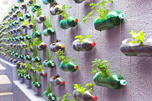 "urbangreens:  Recycled Plastic Bottle Vertical Garden  ""Design studio, Rosenbaum, designed this garden as an inexpensive small space solution for growing herbs and spices…  All you need is emptied and cleaned 2-liter PET bottles, scissors, clothesline rope, twine or wire, and two washers per bottle."" More pictures at Treehugger  via captainplanit  This would be a fun project"
