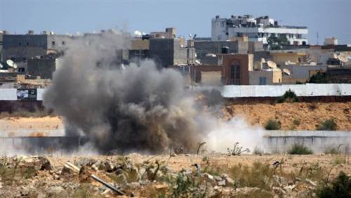 breakingnews:  Libyan rebels have breached the outer wall of Ghadafi's compound in Tripoli. A Russian official says he spoke to Gadhafi by phone, and he quotes him as saying he is in Tripoli and will fight to the end. More updates. (Photo: Sergey Ponomarev / AP)