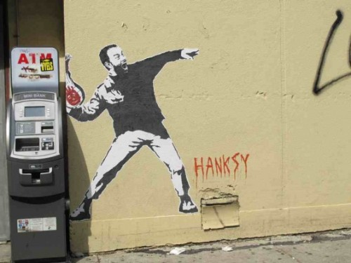 "A NEW Hanksy piece has been spotted on Rivington between Chrystie and Bowery next to the atm machine. It's Tom Hanks in his ""Cast Away"" role, and his volleyball."