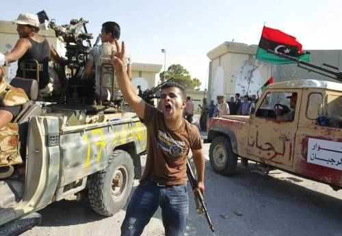 "nationalpost:  Libya rebels seize Gaddafi compoundTriumphant rebels seized Muammar Gaddafi's compound in Tripoli on Tuesday after a fierce battle with a loyalist rearguard but there was no word on the fate of the Libyan leader who vowed again to fight ""to the end.""Reuters journalists watched rebel fighters stream through the sprawling Bab al-Aziziya headquarters compound, firing in the air in celebration after hours of heavy clashes. But it was unclear whether the ""Brother Leader"" or his sons were still somewhere in the complex's maze of buildings and bunkers.Defensive fire died away and hundreds of jubilant rebels poured in. Some smashed a statue of Gaddafi. Others hunted through dozens of buildings, unchallenged, seizing weaponry and vehicles. The rebels' envoy to the United Nations said the area was ""totally in the hands of the revolutionaries.""One man shouted: ""It's over. Gaddafi is finished.""Photo: Libyan rebel fighters celebrate after their entering the Bab al Aziziya compound in Tripoli August 23, 2011. (Zohra Bensemra/Reuters)"