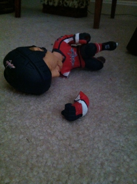 One tragedy of the 2011 DC Earthquake - John Carlson bobble head takes an epic tumble. (@ashleeeysloan) Hope everyone is safe out there.
