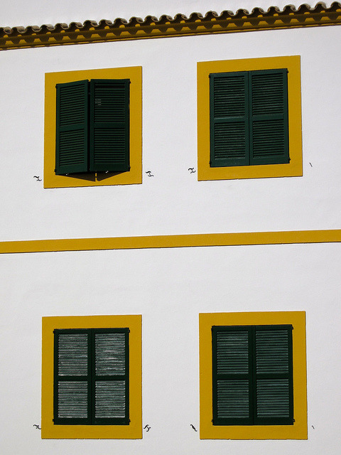 Ibiza, Old Town, Dalt Vila on Flickr.Wandering around the Old Town of Ibiza. This building stood out. Bold yellow windows and green shutters set into the white washed wall. The combinations of these colours are intense and full of vibrancy.