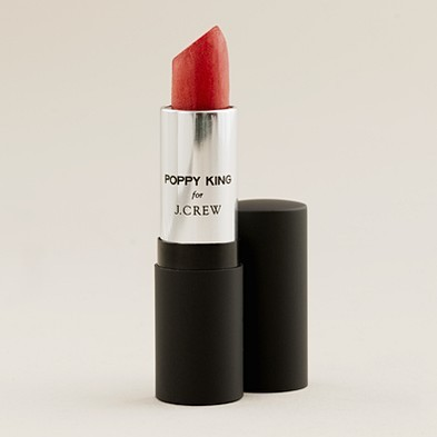poppy king for j.crew lipstick, $18.  j.crew girls are KNOWN for their lips.  the rest of the makeup is very simple and fresh, but the lips always pop.  they're the reason i ran out to buy heat wave and funny face (both by nars) after i read they use them for their shoots.  coral works on almost every skin tone.  can't wait!