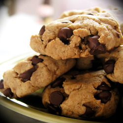 Happy Vegan Chocolate Chip CookiesIngredients (use vegan versions):    2 cups unbleached flour    2 teaspoons baking powder    1/2 teaspoon salt    cinnamon, to taste, optional    handful vegan chocolate or carob chips    1 cup raw sugar (turbinado; sucanat works too, but sucks up a lot of the moisture)    1/2 cup canola or vegetable oil    1 teaspoon vanilla    1/4 cup waterDirections:1. Very important-make sure all ingredients are at room temperature. It will work if they're not at room temp but it works much better if they are. Also while your oven is pre-heating put the cookie sheets you are going to use on top of the oven so they get preheated as well. Preheat oven to 350 degrees F.  2. In a large bowl, mix together flour, baking powder, salt, and cinnamon. Stir in chips. Make a well in the center and set aside. In a medium size bowl, add together sugar and oil; mix well.  3. Add the vanilla and then add the water; mix well.  Add the wet to the well in the dry. Mix it well but be careful not to overwork it.  Add more chips if you need to.  4. Spoon onto ungreased cookie sheets.  Put them in the oven.  Bake for 5 minutes and then flip and rotate the sheets (top to bottom and 180 degree rotation). Bake another 4 minutes and check them. The cookies are done when they seem a little bit softer then you want them to be. They will harden up some as they cool. I usually go in 2 minute increments from here until they get to where I like them.5. Take them out when they are done and move them to wire cooling racks. If they split or come apart when you try to remove them let them sit on the pan for 2 minutes before transferring them to the racks.These cookies have come a long way, lots of time and tasting spent on getting them to where they are now. Vegans and non vegans love them. In the words of my 6 year old son:Mom, you're the greatest because you know how to make the best cookies. Enjoy and let me know if you have questions. Sweet travels.Serves: almost 2 dozen; Preparation Time: 10 minutes; Cooking Time: 10 to 12 minutes