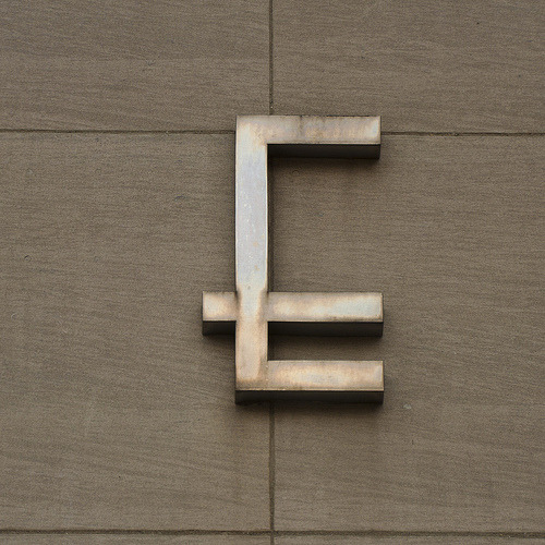 twentysixtypes:  eccentric E (by cityNnature) Lettering from the Himelhoch Buildings facade, Washington Boulevard, Detroit.