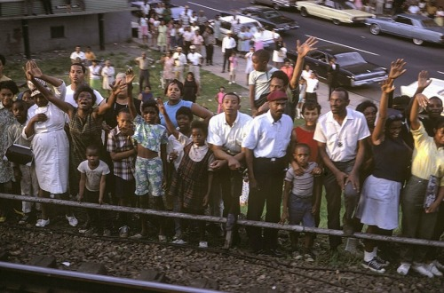 inothernews:  monicagellerb:  Paul Fusco | RFK Train  After he was assassinated in 1968 — the same year Martin Luther King, Jr. was felled by a sniper's bullet, and just five years after his brother, John, was killed by Lee Harvey Oswald — a funeral train carried Robert Kennedy's body from New York City to Washington, D.C.  Photographer Paul Fusco was aboard that train, capturing images of some of the estimated one million people who came to watch and pay their final respects as the train passed.