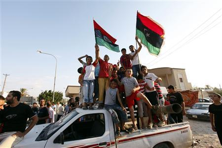 "thepoliticalnotebook:  Libya: The International Response This is the list of countries that currently recognizes the NTC: Albania, Australia, Austria, Bahrain, Belgium, Britain, Bulgaria, Canada, Croatia, Denmark, Egypt, Finland, France, Gambia, Germany, Greece, Iraq, Italy, Japan, Jordan, Kuwait, Latvia, Lebanon, Luxembourg, Maldives, Malta, Montenegro, Morocco, Netherlands, Nigeria, Palestinian Authority, Panama, Portugal, Qatar, Senegal, Slovenia, Spain, Tunisia, Turkey, United Arab Emirates, United States. /Al Jazeera Live Feed China has not recognized the NTC, but essentially sends its best wishes, saying: ""We have always attached significance to the important role of the National Transitional Council in solving Libya's problems, and maintain contact with it.""/BBC Live Feed Russia's Dmitry Medvedev has said that they would consider formal relations if the NTC proves that they can provide a ""new democratic start.""/Reuters The European Union is working to unfreeze Libyan assets and remove sanctions, and is pursuing a UN resolution in the initial stages to do so./Al Jazeera Live Feed The US is also working to unfreeze the Libyan assets they hold./US Dept of State NATO's Admiral Giampaola di Paolo says that "" the game is not over yet. Therefore we will continue the mission to uphold the UN resolution""  And also that ""there may be other boots on the ground, but not Nato."" /BBC Live Feed NATO, which has been striking in and around Tripoli today, also says that it is not their job to find Gaddhafi. /BBC Live Feed Photo: Libyan children celebrate in Janzour. Photo Credit: Ismail Zitouny/Reuters"