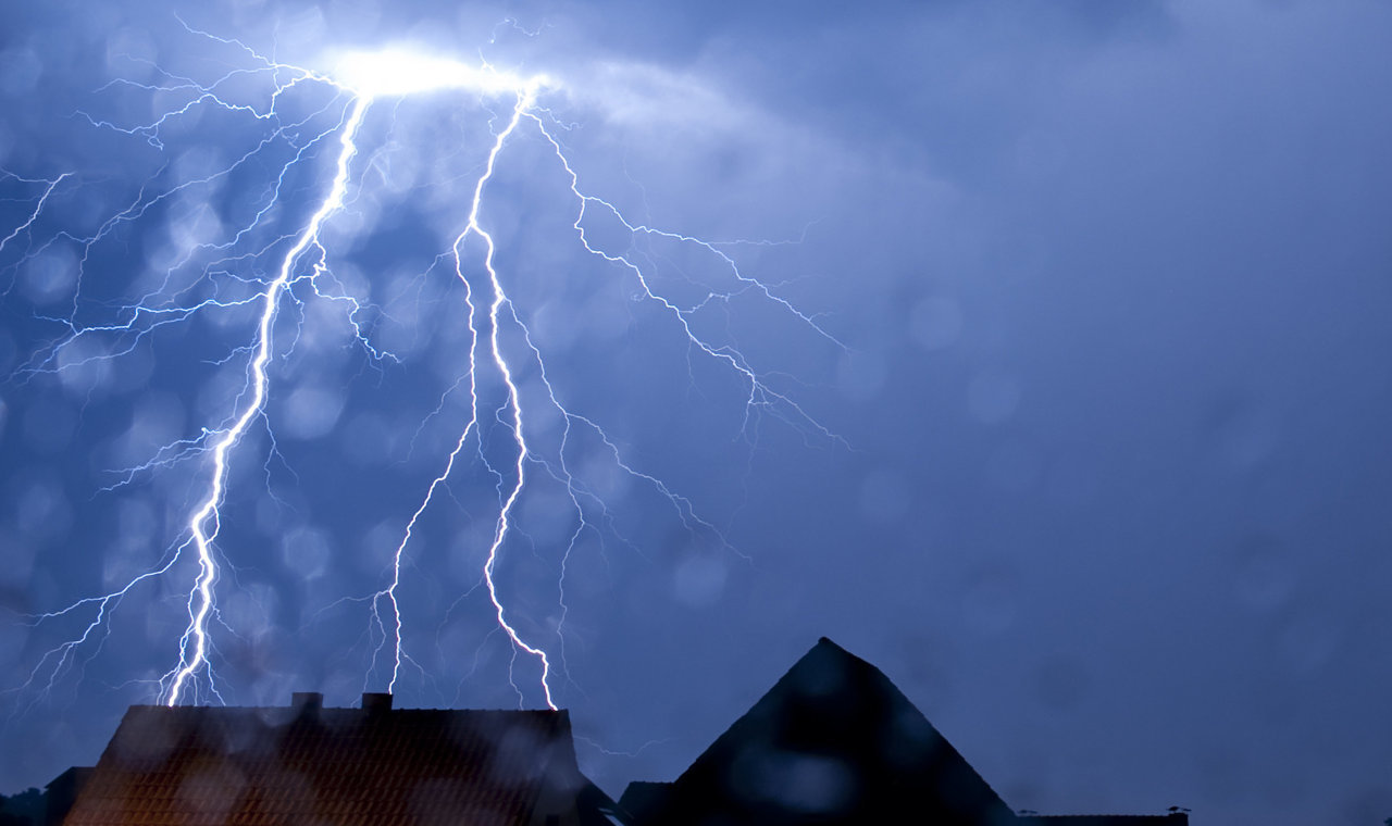Photos of the dayLightning strikes behind a house in the northern German city of Gesecke, Aug. 23, 2011. (Thomas Rensinghoff/AFP/Getty Images)