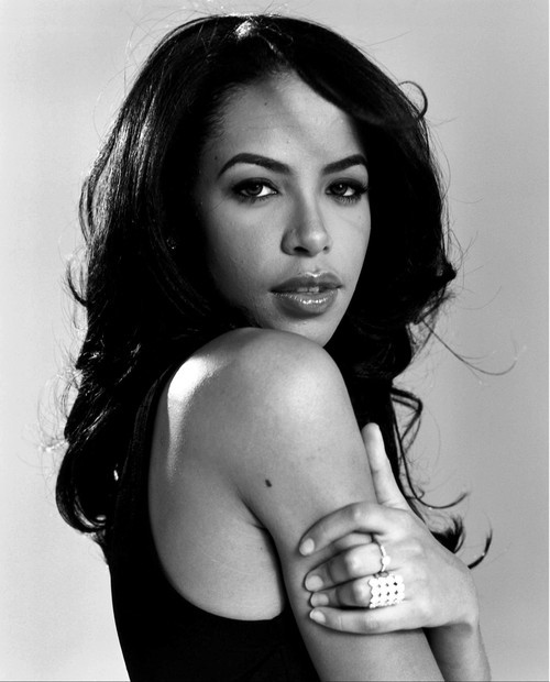 "10 years ago today we lost Aaliyah. My favorite song will always be ""One in a Million"" because I wrote my first song over that beat. I remember wanting to dress like her, move like her,and sing like her. Hell, my first 10 years of haircuts involved bangs almost always covering my eye because of her. Rest in Peace."