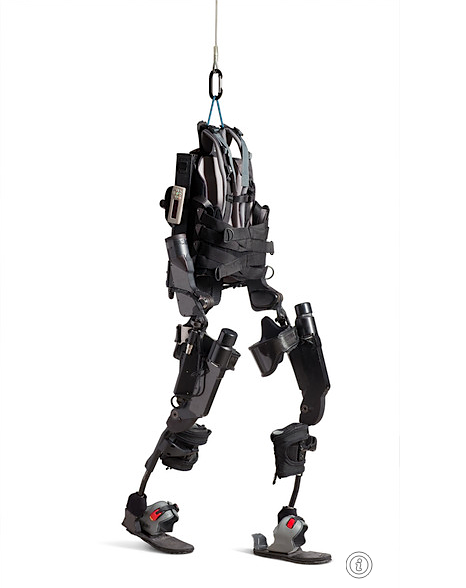 "Last fall California-based Berkeley Bionics unveiled a ""wearable robot"" called eLEGS, an exoskeleton adapted from technology currently being tested for U.S. foot soldiers. Users strap on a backpack containing a battery and microprocessor, then bionic legs with motorized joints at the hips and knees. Sensors in handheld crutches issue instructions to the backpack computer, which relays them to the legs. Walking is simple: Shifting weight to the left crutch, for example, initiates a step forward with the right foot. Trials begin this year."