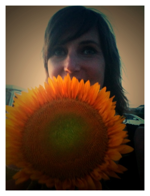 Lyndsey and a sunflower for her birthday.