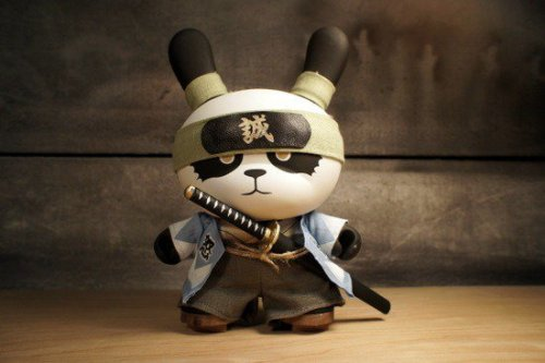 "Absolutely love Huck Gee's latest custom Dunny, Ornery Panda Shinsengumi!  Only ten of these bad boys were made and each one sells for $750 USD.  Also, keep an eye out for the 3"" version of this ornery panda to be included in Huck Gee's recently announced Gold Life Dunny Series.  Congratulations to Huck Gee on continuing to put out some high quality urban vinyl works."