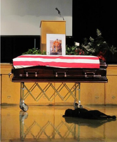 npr:  The dog of slain Petty Officer Jon Tumilson refused to leave his side during the Navy SEAL's funeral earlier this week in Rockford, Iowa. The heartbreaking photo taken by his cousin, Lisa Pembleton, shows Tumilson's dog Hawkeye lying by the casket. (via The Daily Treat: Animal Planet)