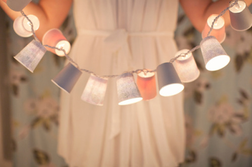 DIY Dixie Cup Light Garland. From The Loveliest Day here. Use must use LED Christmas Lights, they are cooler (meaning that you won't burn accidentally burn your house down).