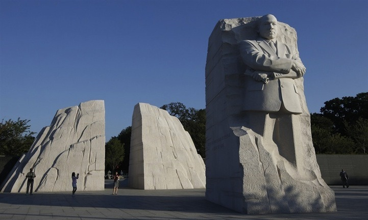 "MLK Memorial Unveiled One of America's greatest civil liberty leaders, Martin Luther King Jr., was honored this week with a long-awaited statue that was revealed at the National Mall in Washington, DC, the same place King made his iconic ""I Have a Dream"" speech. To reach the memorial, visitors walk through two large stones with a gap in between. The giant 30 ft statue, the first on the Mall to honor a non-U.S. president, sits in a direct line between existing memorials dedicated to Abraham Lincoln and Thomas Jefferson. The memorial also features a 450 ft-long granite wall inscribed with 14 of his most memorable quotations. ""I've seen probably 50 sculptures of my dad, and I would say 47 of them are not good reflections — that's not to disparage an artist,"" said Martin Luther King Jr.'s son, Martin Luther King III. ""This particular artist — he's done a good job."""
