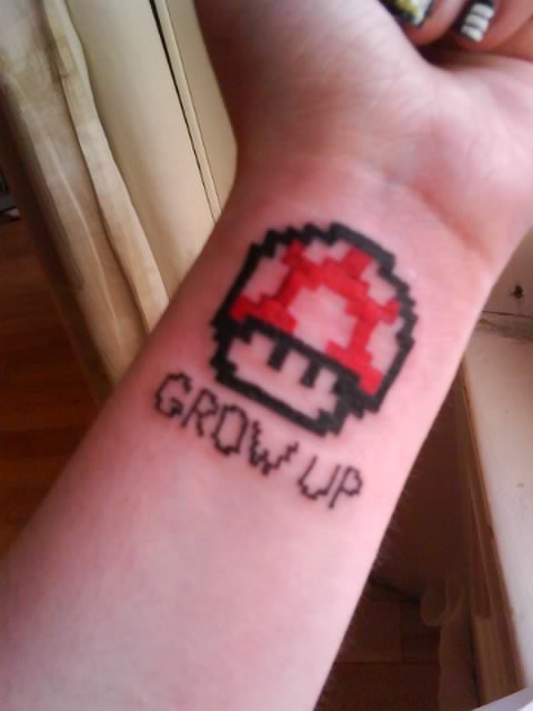 Got this tattoo on the 24th August 2011. It's my first ever tattoo so I wanted to make it a good one.The story behind this tattoo is very simple: I love Super Mario. Not only Super Mario, but all video games. I've been playing Super Mario since I was 3 years old and now, this year, I'm turning 18 and I think it's time I took the red mushroom and grew up :)Done by freelancing tattoo artist Paddy Bullman in Cork, Ireland.