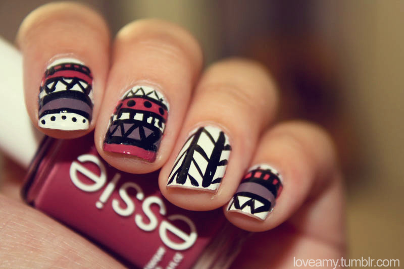 loveamy:  Tribal nails!  I dont usually like the whole tribal thing, but these are very cool :D