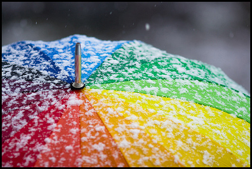 Even when the weather is gray, a rainbow umbrella can brighten your day