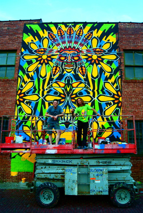 findingtulsa:  Painting Downtown I met these awesome artists, Jake and Rick, downtown.  They were working on the Indian Warrior, the world's second largest stencil (they also created the first largest stencil).  Follow their progress on twitter @mothmanstudios