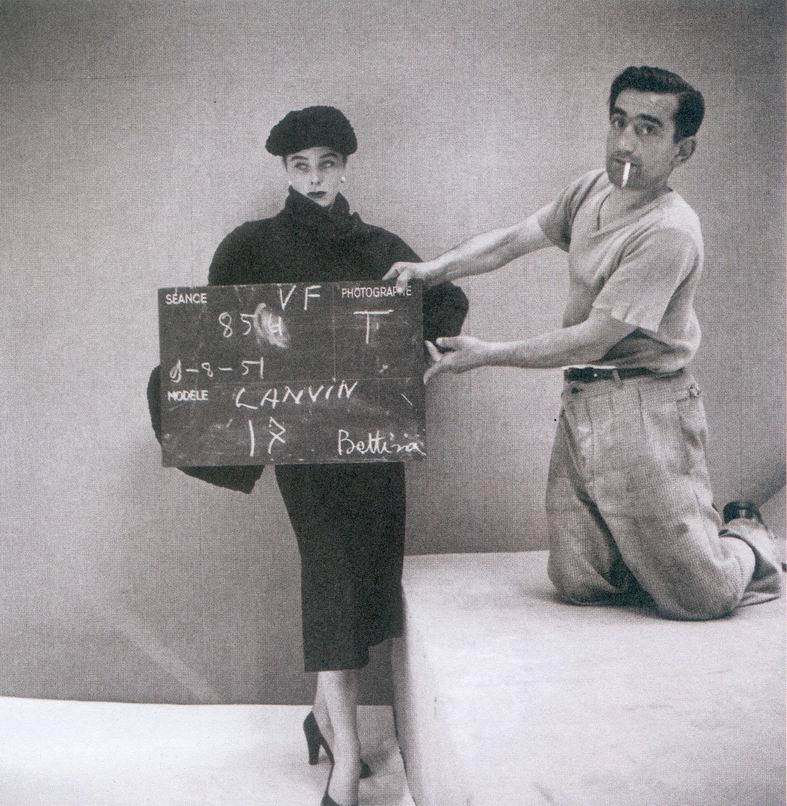 theniftyfifties:  Henry Clarke setting up a photoshoot with Bettina (wearing Lanvin), 1951.