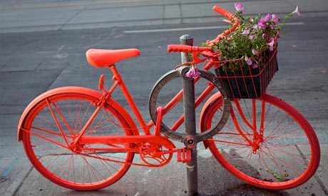 Via unconsumption:  Upcycled bicycles  Caroline Macfarlane and Vanessa Nicholas, from Toronto's OCAD University, gave a bright face-lift to an abandoned Raleigh as a work of art, and part of the Good Bike Project. They hope to make it a city-wide phenomenon.  (via guardian.co.uk)  Also in Toronto: Bicyclists have turned bike posts into mini-gardens, with plants planted in empty plastic bottles. (A Gardens in Unexpected Places post about it is here.)