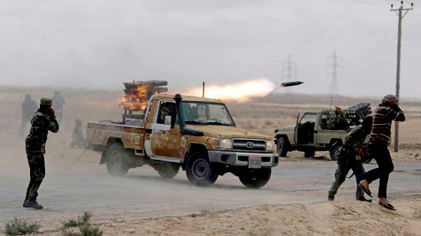 Hilux and Land Cruiser still at the heart of the action in Libya. Rocket propelled grenade launcher not on the factory option list.