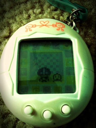 "My roommate(Jay)  and I's ""love pet"" (Tamagatchi) aka ""Pekay"", had a baby just now!! Yay I'm a grandma!! Lol Got off work at 2, about to run/yoga, and then fashion show tonight. :]] I'm having a pretty wonderful day, how about you?"