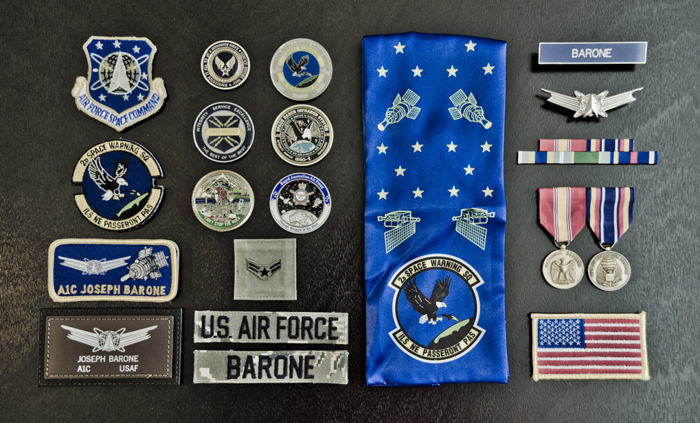 spacedriver:  My United States Air Force accoutrements, patches, and coins. Air Force Space Command, 2nd Space Warning Squadron, Buckley Air Force Base, Colorado (Of course, I submitted to Things Organized Neatly!)