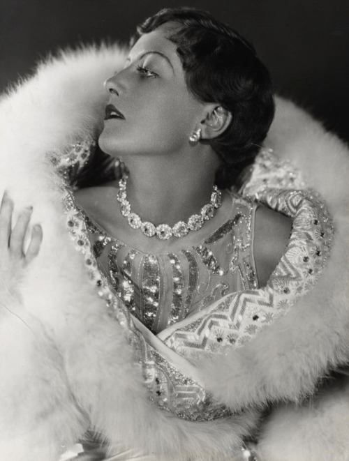 Joan Crawford, wearing a beaded and sequined fur wrap and beaded gown,  in 1926 Photographed by Ruth Harriet Louise Image Source
