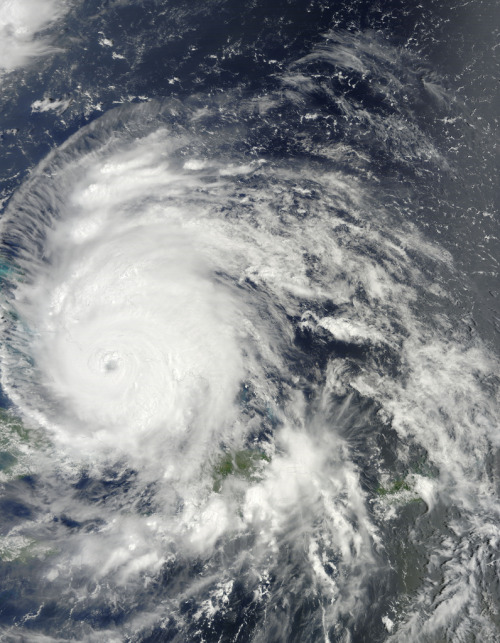 "justinreadsthenews:  The Latest on Hurricane Irene: 200,000 tourists are evacuating from North Carolina. (LA Times) It's likely to cause more injuries in the Bahama's than 1999's Hurricane Floyd, and it really looks like it's heading for the New York City area. (Reuters)  NBC is worried Irene is going to attract online scammers to infect your computers with spyware and malware. Here's how to avoid it. While the hurricane is expected to cause as much as $20 billion in damages, it's helping businesses like Lowe's, Target, and Home Depot because of boosts in sales of emergency supplies. (Bloomberg) ""This is everything a hurricane can be, and it's on one of those worst-case tracks for the East Coast,"" Dennis Feltgen, a spokesman for the National Hurricane Center told NPR. ""Usually, hurricanes that get up into the higher latitudes are fast-moving,"" he said. ""This one isn't — which means it will be a powerful, slow-moving storm that could be doing a lot of damage."" North Carolina, New York, and New Jersey have already declared a state of emergency ahead of the hurricane's arrival. Whether or not NYC will order evacuations is still to be determined. (Photo via NASA Goddard Photo and Video's Flickr)  Great Irene roundup via our former intern, Justin Jones."