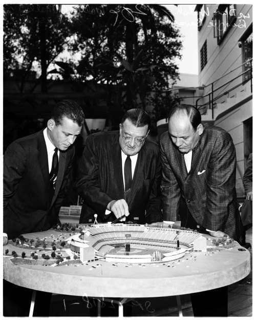 Walter O'Malley (center) refers to a model of Dodger Stadium on this day in 1960.
