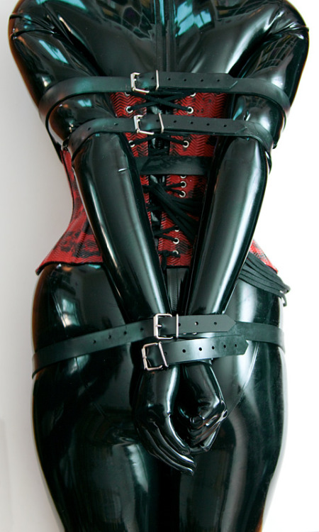 Now that's some restricting rubber bondage. Lovely!  By Steelfinger.